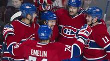 Montreal Canadiens' Max Pacioretty (67) celebrates with teammates Josh Gorges, left, Alexei Emelin, Brendan Gallagher (11) and David Desharnais (51) after scoring against the Pittsburgh Penguins during second period NHL action in Montreal, Saturday, November 23, 2013. (Graham Hughes/THE CANADIAN PRESS)
