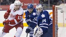 Detroit Red Wings' Pavel Datsyuk, left, scores on Toronto Maple Leafs goaltender James Reimer as teammate John-Michael Liles looks on during first period NHL action in Toronto on Saturday, December 21, 2013. (Chris Young/THE CANADIAN PRESS)