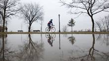 A man cycles on a foggy Sunday morning on Toronto's waterfront. (Matthew Sherwood for The Globe and Mail)