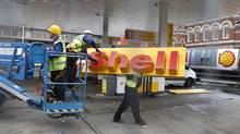 Workers dismantle a Shell petrol station in England, Nov. 8, 2011. Shell says its Nigeria joint venture is losing 43,000 barrels a day of crude oil to theft, while deliberate damage to pipelines accounted for more than three-quarters of oil spilled last year. (CHRIS HELGREN/REUTERS/CHRIS HELGREN/REUTERS)
