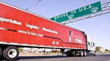 A truck drives towards the United States border in Windsor, Ont. (GEOFF ROBINS/GEOFF ROBINS/THE GLOBE AND MAIL)