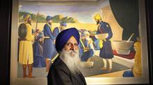 Dr. Raghbir Bains proudly displays one of many historic Sikh paintings, this one depicting the inauguration of the Khalsa brotherhood, in preparation for the opening of a new Sikh museum Oct 8, 2010. (Moe Doiron/The Globe and Mail/Moe Doiron/The Globe and Mail)