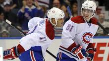 Montreal Canadiens' Scott Gomez celebrates his goal with Raphael Diaz against New York Islanders goalie Evgeni Nabokov in the thir