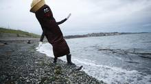 Local sewage activist James Skwarok, also known as Mr. Floatie, dips his boot into the water recently near Clover Point in Victoria (CHAD HIPOLITO/THE CANADIAN PRESS)