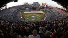 Fans at Citi Field watch the opening ceremony before baseball's All-Star Game on Tuesday in New York. (Julio Cortez/The Associated Press)