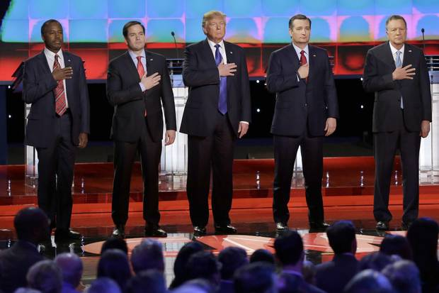 The five Republican presidential candidates listen to the U.S. naitonal anthem before a televised debate in February.