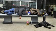 In this Sept. 2005 file photo, men sleep after drinking on a bench in downtown Moscow. (Alexei Sazonov/AP)