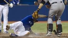 Baltimore Orioles catcher Matt Wieters, right, puts the tag on Toronto Blue Jays Brett Lawrie for the out trying to steal home in the second inning of their game in Toronto on Sunday. (FRED THORNHILL)