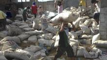 Looters take bags of rice to ship to far-off communities in the Philippines. (Nathan VanderKlippe/The Globe and Mail)