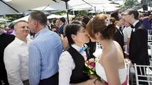 Over 100 gay couples participate in a mass wedding during World Pride 2014 at Casa Loma in Toronto, Ont. on Thursday, June 26, 2014. (Darren Calabrese/THE CANADIAN PRESS)
