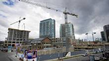 Workers are seen at a condo development in the Liberty Villiage area in Toronto on April 11, 2012. (Kevin Van Paassen/The Globe and Mail)