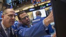 Traders work on the floor of the New York Stock Exchange February 24, 2014. (BRENDAN MCDERMID/REUTERS)
