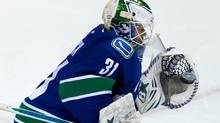 Vancouver Canucks' goalie Eddie Lack, of Sweden, makes a glove save against the Winnipeg Jets during second period NHL hockey action in Vancouver, B.C., on Sunday December 22, 2013. (DARRYL DYCK/THE CANADIAN PRESS)
