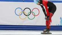 Canada's Charles Hamelin reacts after crashing during the men's 500 metres short track speed skating heats event in the Iceberg Skating Palace at the Sochi 2014 Winter Olympic Games February 18, 2014. (ALEXANDER DEMIANCHUK/REUTERS)