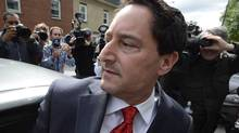 Montreal Mayor Michael Applebaum gets into a car outside police headquarters in Montreal, June 17, 2013. Applebaum was arrested earlier as part of a bribery case. (Ryan Remiorz/THE CANADIAN PRESS)