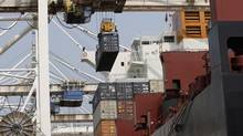 Container ships are loaded and unloaded at the TSI Terminal Systems Inc at Deltaport in Delta, B.C. in this file photo. (Lyle Stafford For The Globe and Mail)