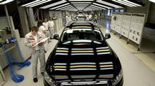 Employees of Audi work at an assembly line in Ingolstadt, southern Germany, in a file photo from February, 2012. About 3.6 million workers in Germany's auto industry received a large pay raise in May. (Lukas Barth/Associated Press)