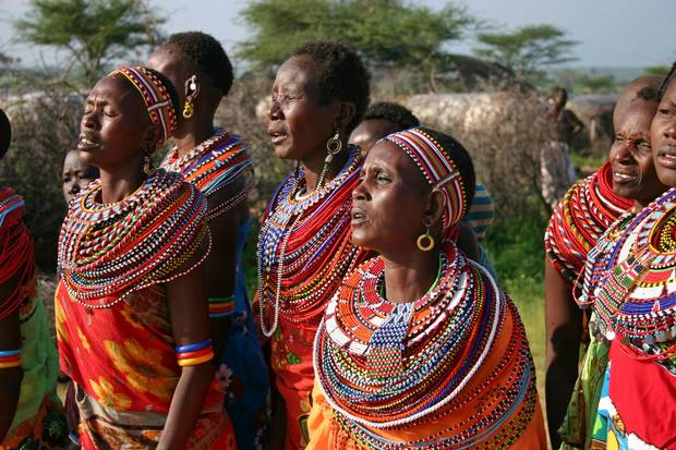 A group of Samburu women dance and sing in Kenya in 2004. is dancing and singing in traditional way.