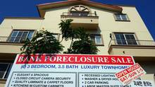 "A ""bank foreclosure sale"" sign is posted in front of townhomes on August 12, 2010 in Los Angeles, California. U.S. banks repossessed homes at a near record pace to drive up July foreclosures. (Kevork Djansezian/ Getty Images/Kevork Djansezian/ Getty Images)"