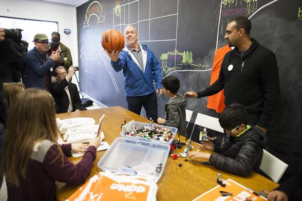 BC NDP Leader John Horgan, centre, plays with a basketball during a visit to BC NDP candidate Ravi Kahlon's, right, campaign office in Delta, B.C., on Monday.