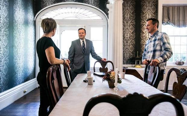 Paul Shelestowsky, centre, senior wealth advisor at Meridian Credit Union, discusses investment strategies with his clients, Melanie Heathers and Matt Roszkowski at their bed and breakfast, the Brockamour Manor, in Niagara-on-the-Lake, Ont.