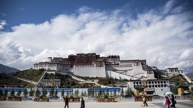 Tourists to Tibet mill around the front of the country's iconic Potala Palase in Lhasa in this picture taken in September, 2011.
