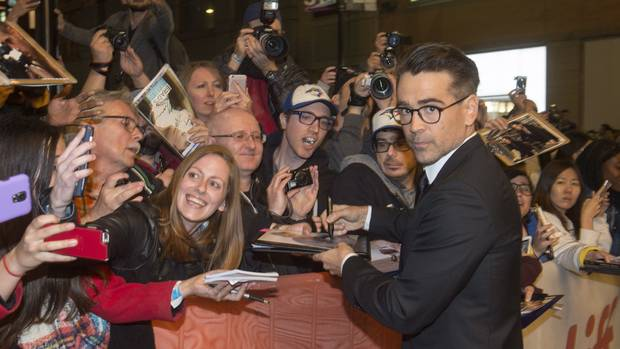 TIFF mainstay Colin Farrell signs autographs for eager fans prior to the premiere of The Killing of a Sacred Deer during TIFF on Saturday, Sept. 9, 2017.