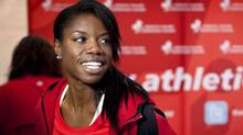 Perdita Felicien smiles at a news conference highlighting the Canadian Track and Field Championships and Olympic Trials in Calgary, Alta., Tuesday, June 26, 2012. (The Canadian Press)