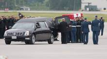 The casket of Master Cpl. Francis Roy is carried to a waiting hearse during a repatriation ceremony at CFB Trenton, Ont. on Wednesday, June 29, 2011. MCpl. Roy died Saturday of causes not related to combat at a forward operating base in Kandahar. (Peter Redman/The Canadian Press/Peter Redman/The Canadian Press)