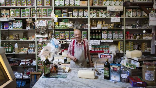 Angelo Tosi, 84, owner of Tosi & Company, the last Italian shop in Chinatown, is photographed at the shop in Vancouver, British Columbia, Thursday, August 11, 2016. His father opened the shop in 1906 and recently Angelo has put the place up for sale because he can't afford the city's taxes anymore.