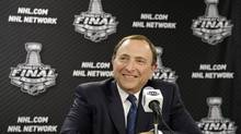 NHL Commissioner Gary Bettman smiles during a news conference before Game 1 of the NHL Stanley Cup Final series between the Chicago Blackhawks and the Boston Bruins, Wednesday, June 12, 2013, in Chicago. (Nam Y. Huh/The Associated Press)