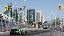 James Hinchcliffe drives in Toronto Indy race in Toronto on Sunday July 14 , 2013. (Mark Blinch/THE CANADIAN PRESS)