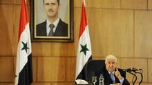 Syria's Foreign Minister Walid al-Moualem speaks during a news conference in Damascus August 25, 2014. (OMAR SANADIKI/REUTERS)