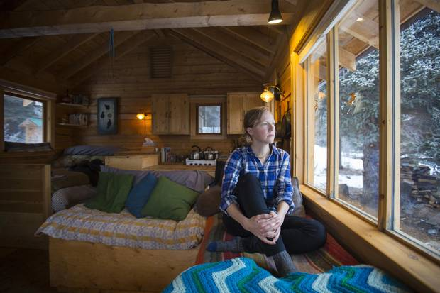 Crystal Schick/Freelance Kate Harris, author of Lands of Lost Borders, looks out the window of her one-room log cabin outside Atlin, B.C. on Jan. 20, 2018.
