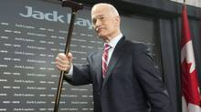 NDP Leader Jack Layton raises his cane as leaves a news conference in Ottawa, Monday April 11, 2011 after speaking about the Auditor-General's report on the G8. Layton died at his Toronto home at the age of 61. (Adrian Wyld/THE CANADIAN PRESS)