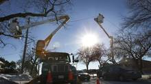Toronto Hydro crews continue to repair lines to homes and offices in Scarborough on Dec. 30, 2013. (PETER POWER/THE GLOBE AND MAIL)