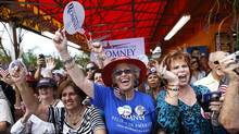 Supporters of U.S. Republican presidential candidate Mitt Romney cheer during a campaign event at El Palacio De Los Jugos in Miami, Florida August 13, 2012. (SHANNON STAPLETON/Reuters)