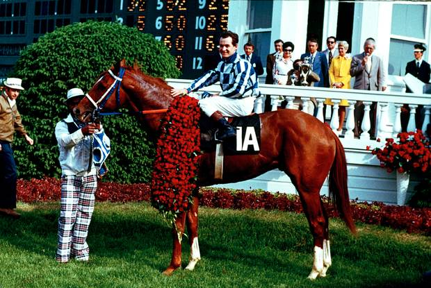 Secretariat and jockey Ron Turcotte pose in the winner's circle after winning the 1973 Kentucky Derby at Churchill Downs in Louisville, Ky., on May 5, 1973. Secretariat won the 99th Run for the Roses in a record 1:59 2/5, becoming the first horse to complete the 1 1/4-mile course for the Kentucky Derby in less than two minutes.