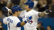 Toronto Blue Jays Brett Lawrie (right) congratulates teammate J.P. Arencibia on his two run homer off New York Yankees starting pitcher Hiroki Kuroda during second inning AL action in Toronto on Wednesday May 16, 2012. (The Canadian Press)