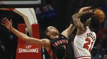 Chicago Bulls' Jimmy Butler is fouled by Toronto Raptors' Jonas Valanciunas during the first half of their NBA basketball game in Chicago, Illinois, April 9, 2013. (JIM YOUNG/REUTERS)