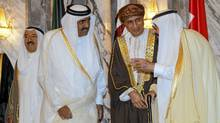 Saudi Arabia's King Abdullah, right, Omani Deputy Prime Minister for the Council of Ministers Sayyid Fahd bin Mahmoud al-Said, second from right, Qatar's Emir Sheikh Hamad bin Khalifa al-Thani, second from left, and Kuwaiti Emir Sheikh Sabah al-Ahmad al-Sabah speak before their meeting in Riyadh, May 14, 2012. (Fahad Shadeed/Reuters/Fahad Shadeed/Reuters)
