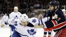 Toronto Maple Leafs' Colton Orr and New York Rangers' Mike Rupp fight during the first period of an NHL hockey game, Saturday, Jan. 26, 2013, in New York. (Associated Press)