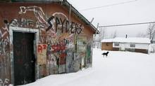 Ninety per cent of the homes in Pikangikum, a first nations community 100 kilometres northwest of Red Lake, Ont., lack running water and sanitary facilities. (John Woods/The Canadian Press)