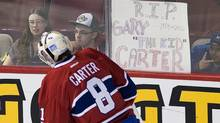 Montreal Canadiens' goaltender Carey Price skates by a sign and wears a jersey im memory of the late Montreal Expos' baseball player Gary Carter prior to an NHL hockey game against the New Jersey Devils in Montreal, Sunday, Februay 19, 2012. THE CANADIAN PRESS/Graham Hughes (Graham Hughes/CP)