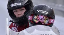Canada's Kaillie Humphries, in front, and Chelsea Valois sit in their bob to win the women's Bob World Cup race in Winterberg, Germany, Saturday, Dec. 8, 2012. (Martin Meissner/AP)