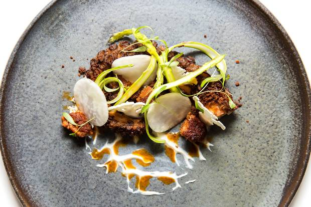 Chewy charred octopus is layered with two types of chorizo – housemade sausage and a spicy vinaigrette.