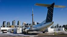 A Porter Airlines Bombardier Q400 turboprop aircraft is parked on the tarmac at Billy Bishop Toronto City Airport. (MARK BLINCH/REUTERS)