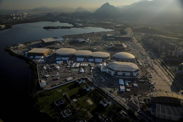 The 2016 Summer Olympics park is seen under construction in this aerial photograph taken above the Barra da Tijuca area of Rio de Janeiro. Brazil's federal government has agreed to provide emergency funding to Rio de Janeiro state after the host of this year's summer Olympics declared an emergency as it runs short of cash weeks before the start of the games.