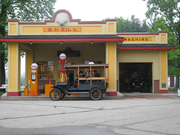 A 1919 Model T sits at a 1930s gas station at the Gilmore Car Museum.