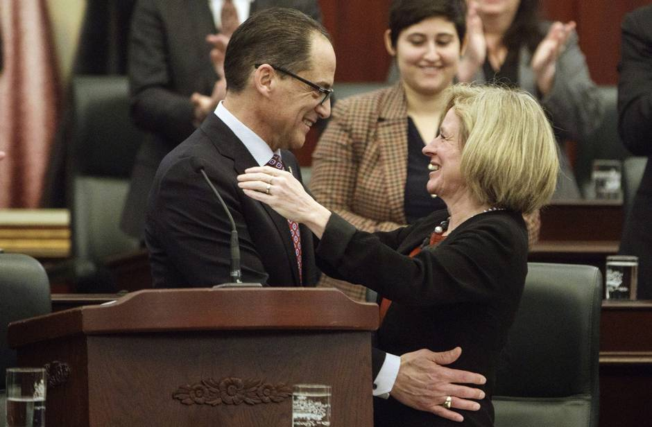 Alberta Finance Minister Joe Ceci and Alberta Premier Rachel Notley embrace after tabling the 2017 provincial budget in Edmonton on March 16, 2017.